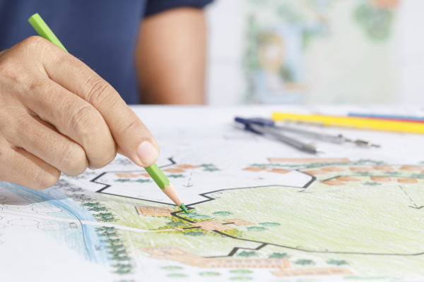 Person Coloring a Landscape Design